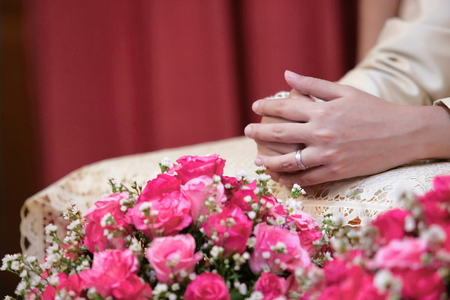 Groom hands in water relaunch ceremony. Thai traditional wedding. Selective focus and shallow depth of field.