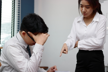 Anxious depressed young Asian business man is being blamed with boss in workplace. Zdjęcie Seryjne - 97060776
