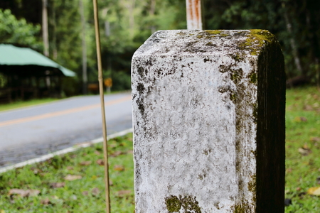 White milestones on countryside road