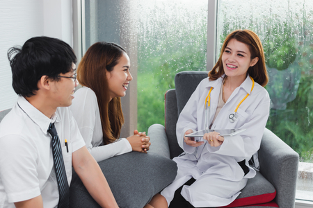 Young Asian female doctor consulting patient in hospital office. Health care and medical concept.