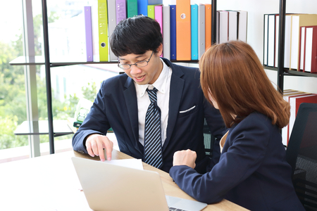 Young Asian partner working together in office. Teamwork business concept Banque d'images