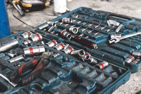 Tools in toolbox lying on the floor. Selective focus and shallow depth of field