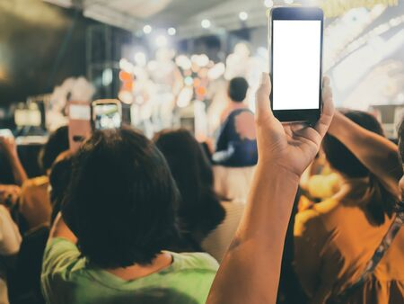 Hands with mobile smart phone recording and taking a picture at music concert Stok Fotoğraf