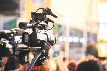 Professional video camera with abstract blurred background