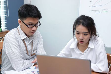 Teamwork business concept. Asian people brainstorming together in modern office.