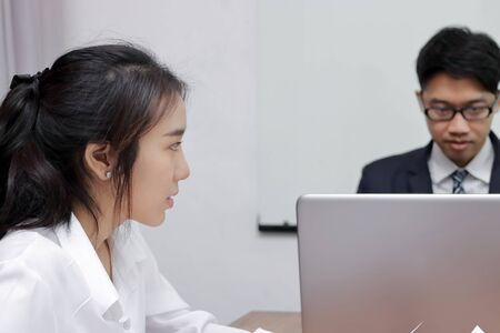 frustrated stressed Asian business female suffering from severe depression during meeting.