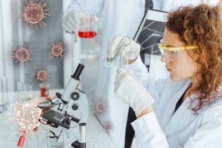 Scientist researcher doing experiments in modern laboratory. Coronavirus flu virus , Covid 19 , Antiviral drugs concept. Foto de archivo