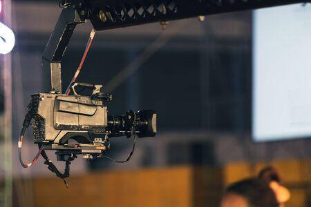 Professional digitak video camera on crane record live on event broadcasting at night concert outdoors. Stock fotó