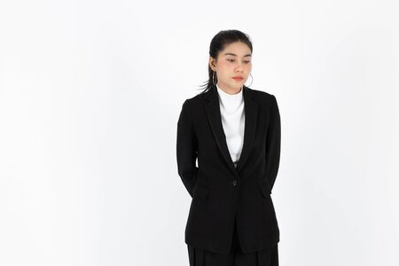Tired sad Asian business woman suffering from severe depression standing over white isolated background. Unemployment and layoff concept.