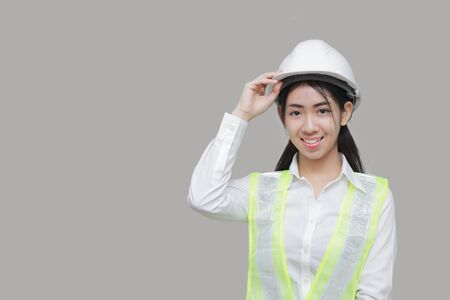 Confident beauty Asian woman worker posing on gray isolated background.