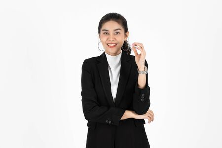 Portrait of attractive young Asian business woman having idea posing on white isolated background.