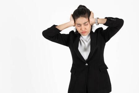 Depressed upset young Asian business woman in suit suffering from severe depression and burnout over white isolated background. Failure and layoff concept.