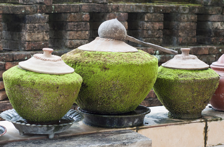 Water jars of the ancient Thai temple in Thailand. photo