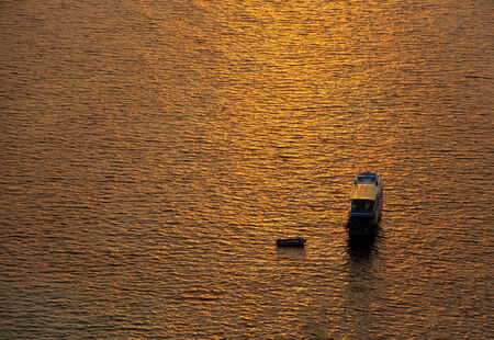 Boats in the sea and the sunset sky photo