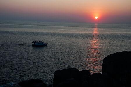 Fishing boat on the sea photo