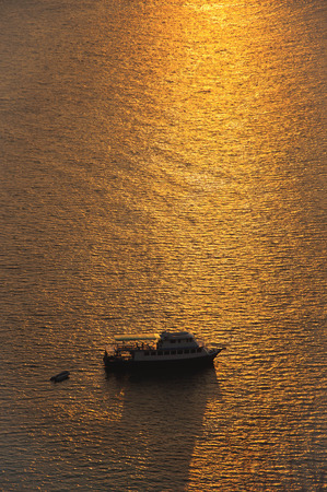 fishing boat going out for a sunset photo