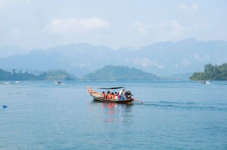 Long-tail boat on Cheow Lan Lake, Khao Sok National Park in southern Thailand photo