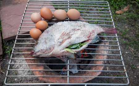 Grilled white snapper fish coated rock salt and egg toast photo