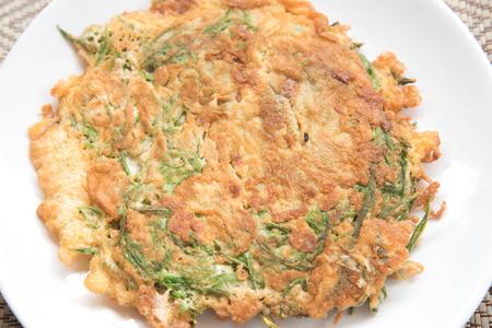 comida italiana: tortilla con alimentos vegetablesClimbing WattleThai