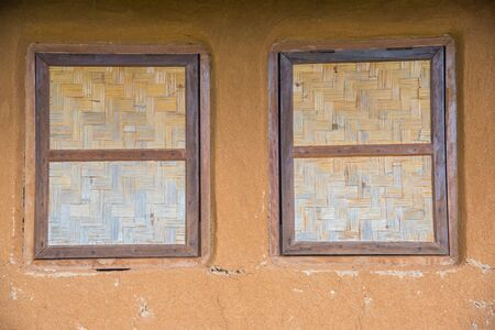 berm: Bamboo wickerwork window of a vintage cob house in Northern Thailand