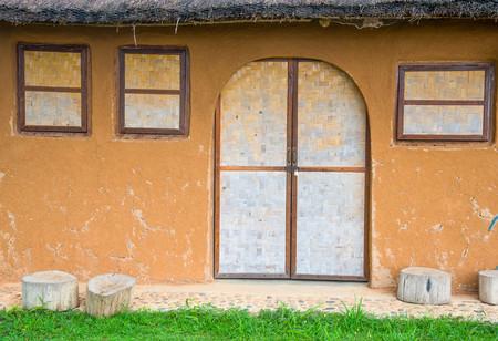 berm: Bamboo wickerwork window and door of a vintage cob house in Northern Thailand