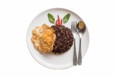 Basil fried riceberry rice mingled with minced pork and fried egg on isolate background