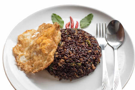 mingled: Basil fried riceberry rice mingled with minced pork and fried egg on isolate background