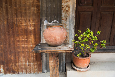 made of water: Thai clay water pot with dipper made from coconut shell Stock Photo