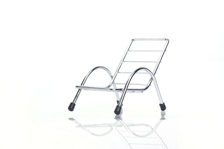 Subject: 45 Degree silver steel chair isolated on white background.