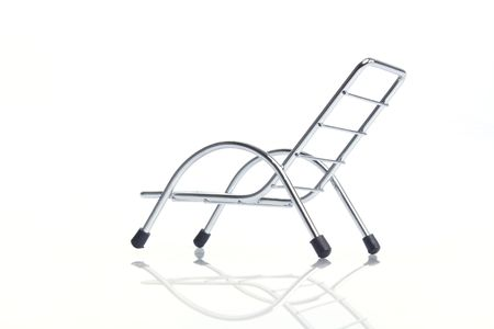 Subject: side view silver steel chair isolated on white background.