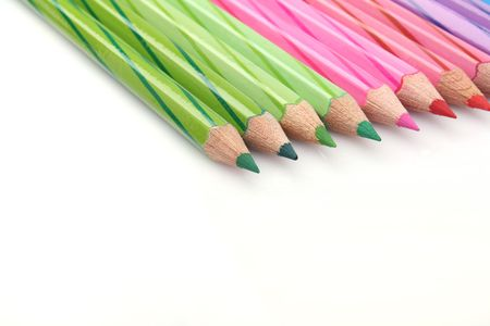 Close up of a row color pencil on white background