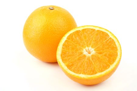 Close up an orange and half a tablet of orange on a white background