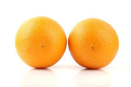 Close up two orange isolated on white background