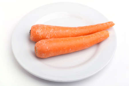 Show Two carrot isolated on white Dish Stock Photo