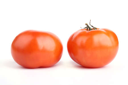 Close up two tomato isolated on white background