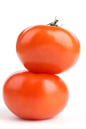 Close up two tomato stand isolated on white background Stock Photo