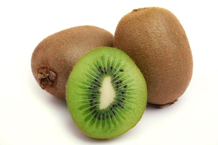 Close up two kiwi and half a tablet of kiwi on a white background