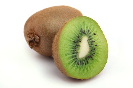 Close up an kiwi and half a tablet of kiwi on a white background Stock Photo