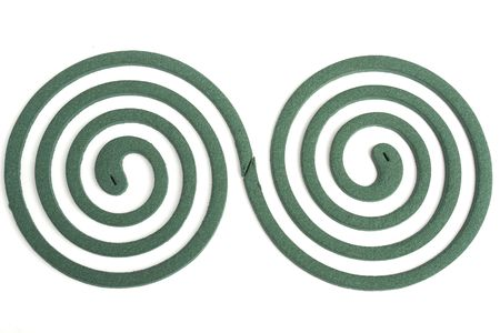 mozzie: Two spiral. Mosquito coil on black background. Stock Photo
