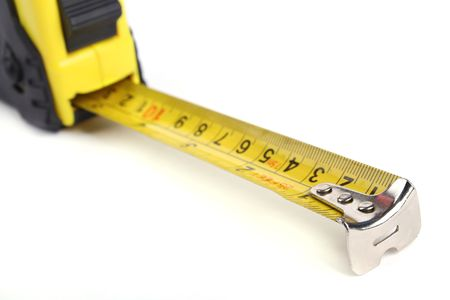 Close up tape measure isolated on a white background. Stock Photo