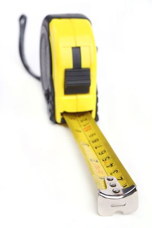 A tape measure isolated on a white background.