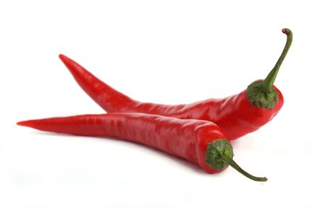 close up two Red chili pepper isolated on white background