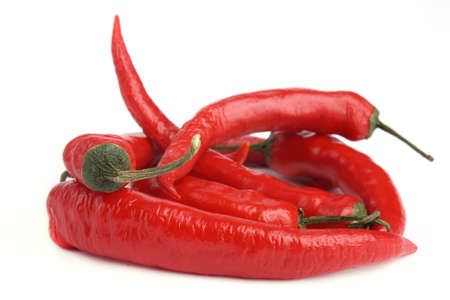 Five Red chili pepper isolated on white