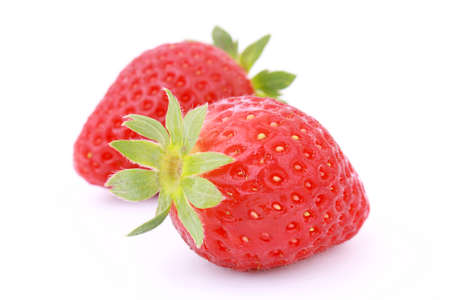 Two fresh strawberries isolated on white background.