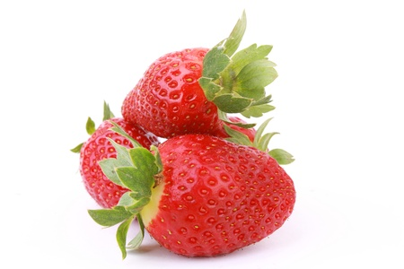 Three fresh strawberries isolated on white background.  Stock Photo