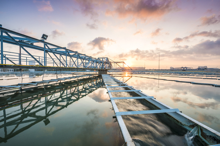 sludge: The Solid Contact Clarifier Tank type Sludge Recirculation process in Water Treatment Plant with Sun Rise Stock Photo