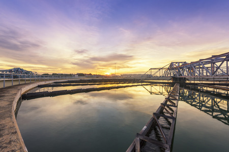 recycling plant: sewage treatment plant with sunrise
