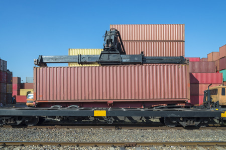 railway transportation: Industrial Container Cargo with working crane to railway transportation to habour in Logistic Import Export area