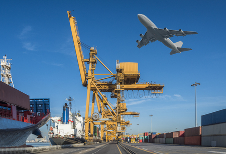 sea freight: Container Cargo freight ship with working crane loading bridge in shipyard