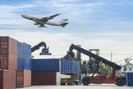 global logistics: forklift handling the container box in logistic zone